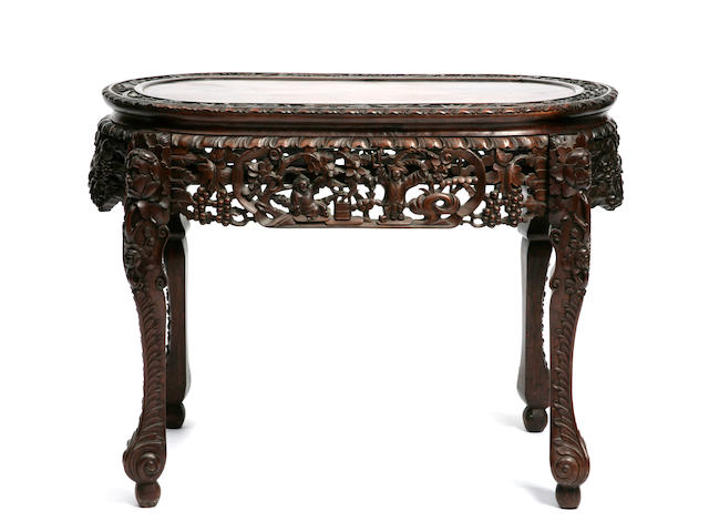 A Chinese export type carved hardwood oval table, with pierced grapevine frieze