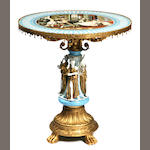 A Continental Neoclassical style gilt metal mounted porcelain center table