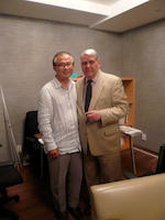Mr. Tom H. John with the artist's son, July 29, 2009