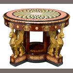 An imposing Empire style gilt bronze mounted inlaid walnut center table