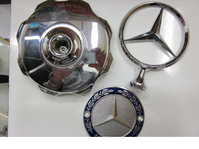 A Mercedes radiator cap three-pointed star,