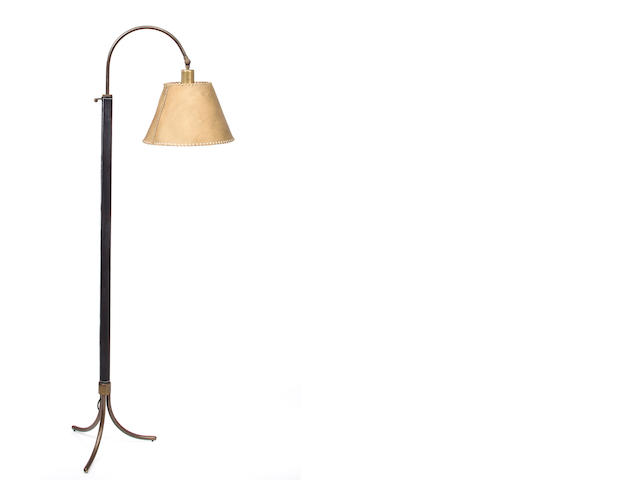 A Jacques Adnet leather and iron floor lamp circa 1955