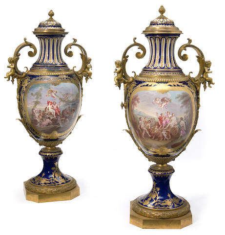 An imposing pair of Sèvres style gilt bronze mounted covered urns  late 19th century