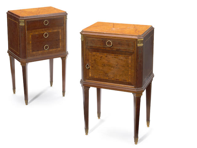 A pair of Louis XVI style gilt bronze mounted inlaid mahogany petite commodes <BR />Haentges Frères<BR />circa 1900