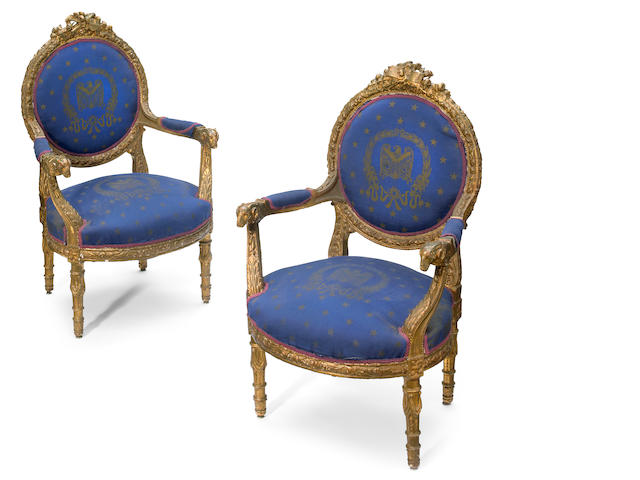 A pair of Louis XVI style carved giltwood fauteuils <BR />second half 19th century