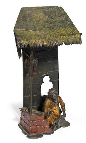 An Austrian cold-painted bronze figural lamp: Meat Vendor circa 1900