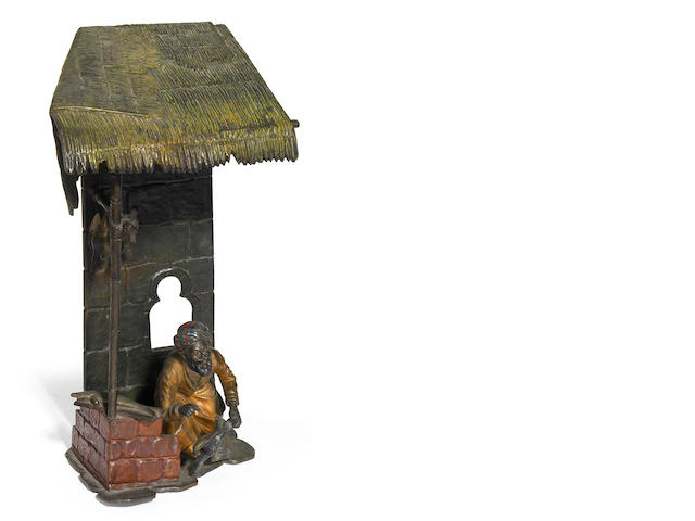 An Austrian cold painted bronze Meat Vendor figural lamp circa 1900