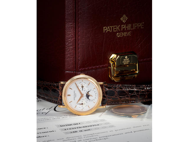 Patek Philippe. A fine 18K rose gold automatic wristwatch with perpetual calendar and moon phasesRef:5039-001, Case no. 4020152, Movement no. 3123910, sold 1998