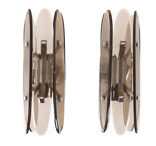 A pair of Fontana Arte smoked glass and chromed-metal sconces circa 1960