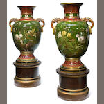 An imposing pair of Continental glazed earthenware vases <BR />late 19th century