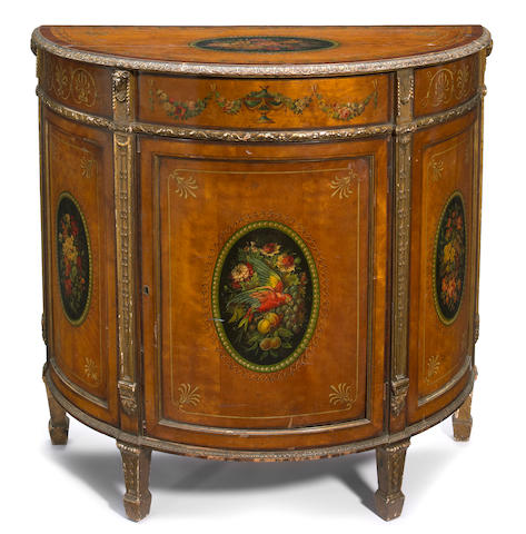 A George III style parcel gilt paint decorated satinwood demilune commode  circa 1900