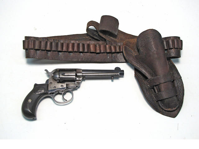 A Colt Model 1877 Thunderer double action revolver with period double loop rig