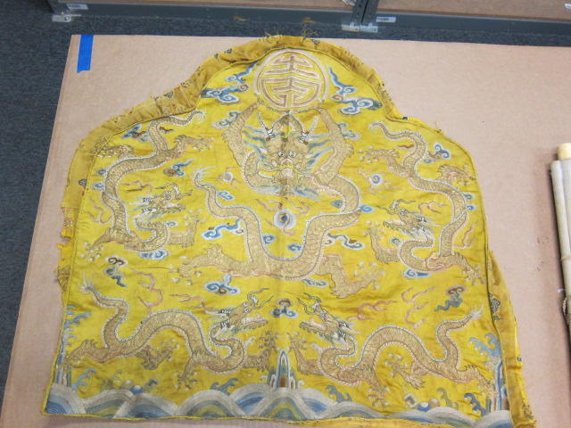A yellow ground embroidered silk throne pillow cover 19th century