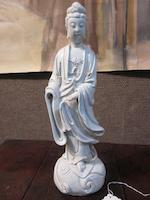 A Chinese blanc de chine porcelain figure of a standing Guanyin