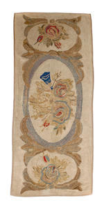 A group of three hooked rugs