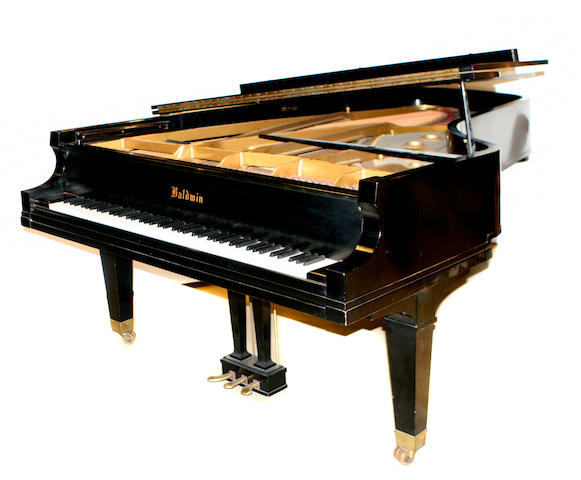 A Baldwin model D ebonized concert grand piano