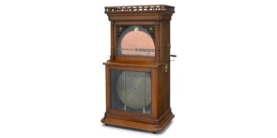 A Regina oak 18 inch disc player with automatic changer <br>early 20th century