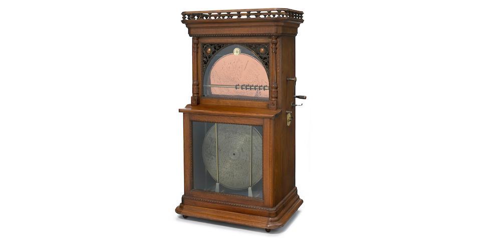 A Regina oak 20 3/4 inch auto changer disc music box circa 1900