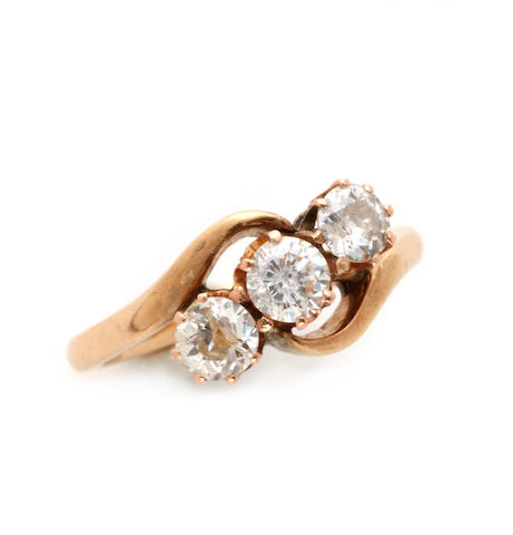 A diamond and gold three stone ring