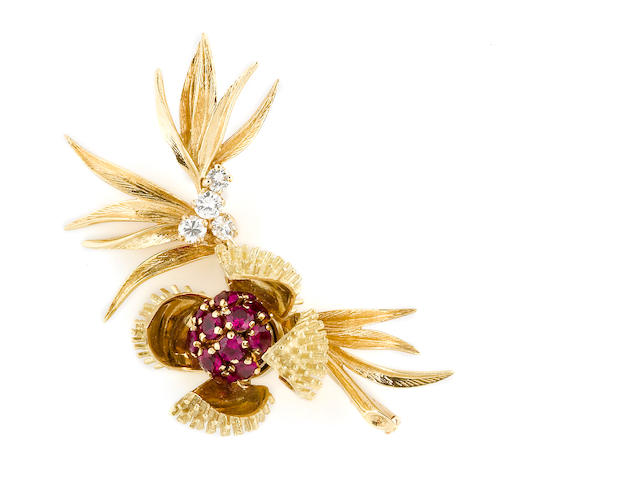 A diamond and synthetic ruby chestnut burr brooch