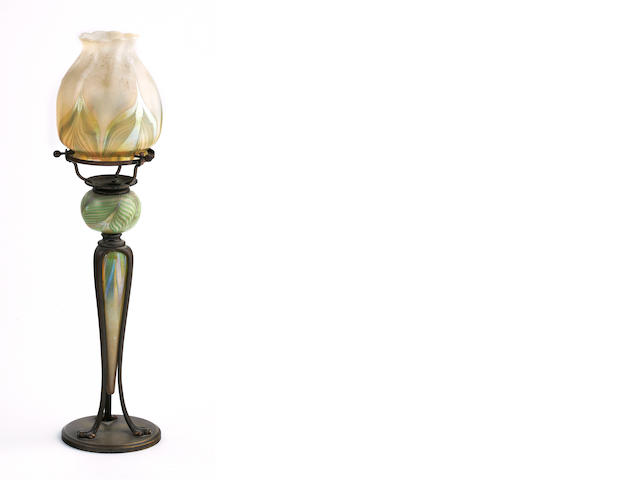 A Tiffany Studios decorated Favrile glass and bronze candle lamp 1899-1918