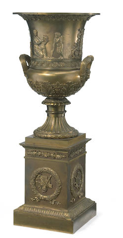 An Empire style gilt bronze mounted urn on pedestal of Campana form <BR />circa 1900