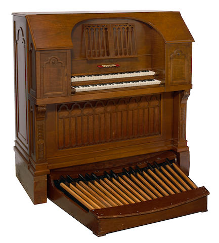An M S Gleason walnut two manual pipe organ with player