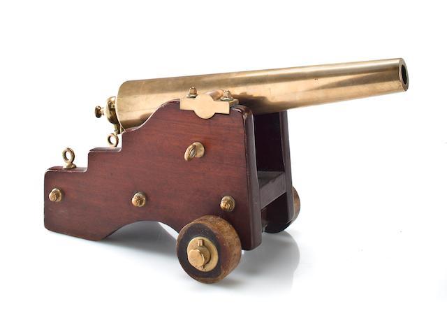 A bronze and mahogany yacht cannon