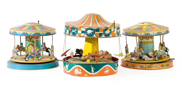 A group of three litho-tin clockwork carousels <BR />Chin and other makers