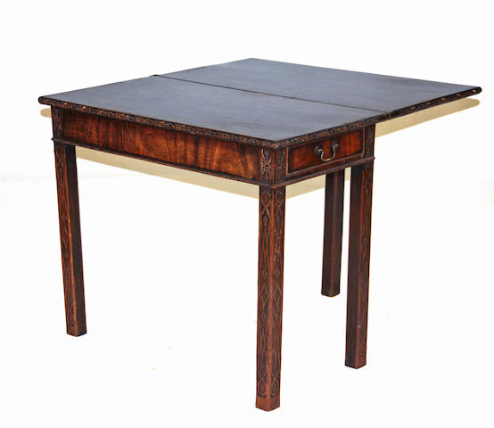 A George III mahogany fold over card table third quarter 18th century
