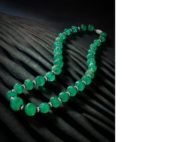 An art deco emerald bead, onyx and diamond necklace, Cartier,