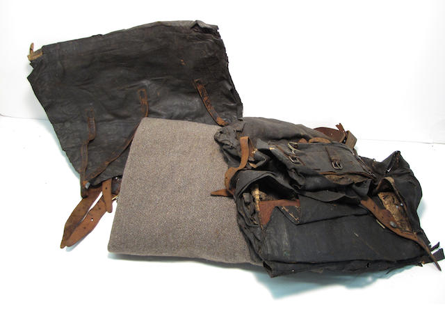 A lot of two Civil War era knapsacks and soldier's blanket