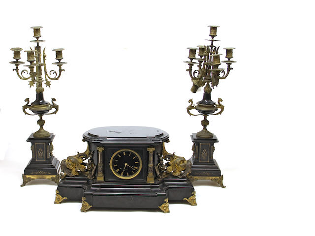 A French gilt bronze mounted black slate assembled three-piece clock garniture late 19th century