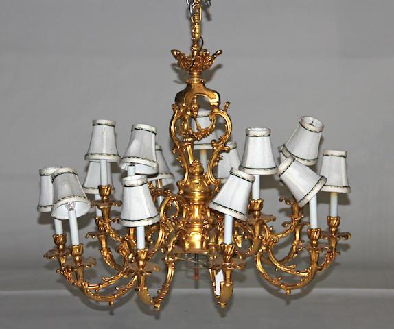A Louis XV style gilt metal fifteen light chandelier