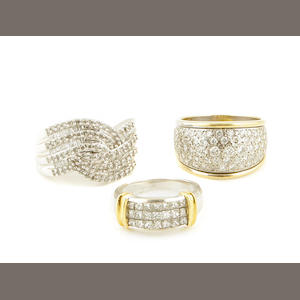 A collection of three diamond, 18k and 14k gold rings