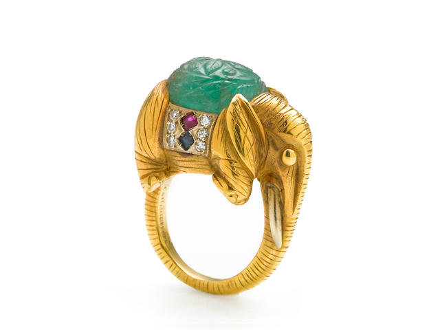 A carved emerald, sapphire, ruby and diamond elephant ring, Cartier, Italy