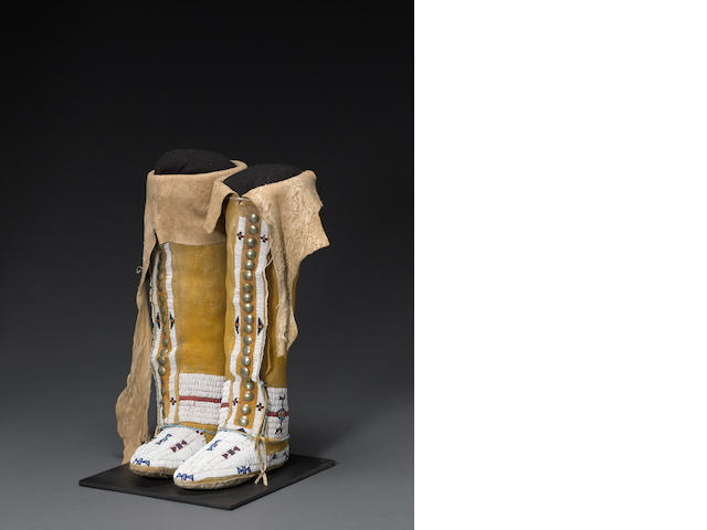 A pair of Cheyenne beaded hightop moccasins