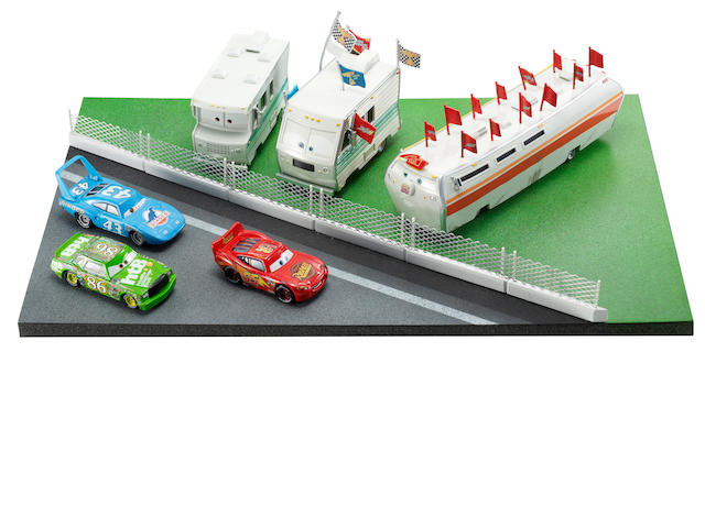 A Piston Cup Race scene display inspired by Disney·Pixar Cars film,