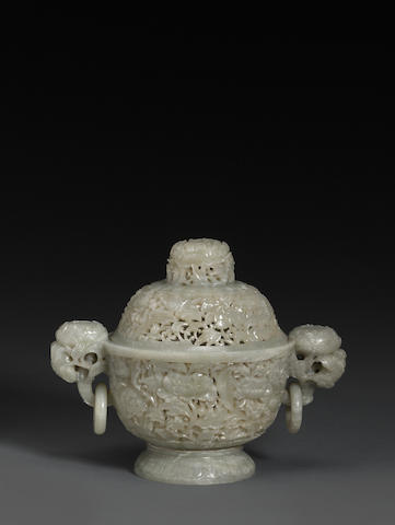A reticulated greenish-white jade covered censer