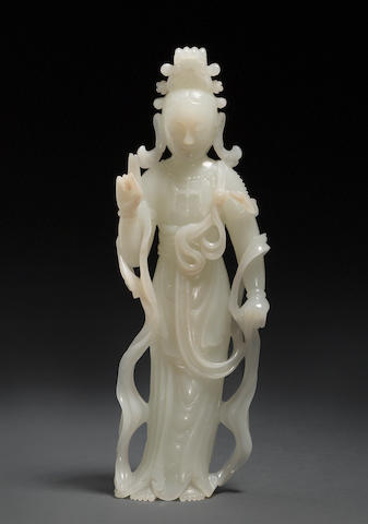 A carved white jade standing figure of a Buddhist deity