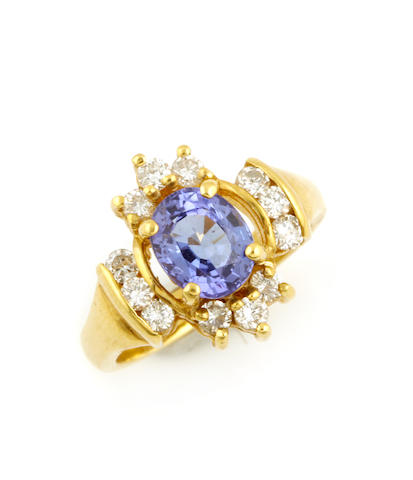 An oval tanzanite, diamond and 18k gold ring