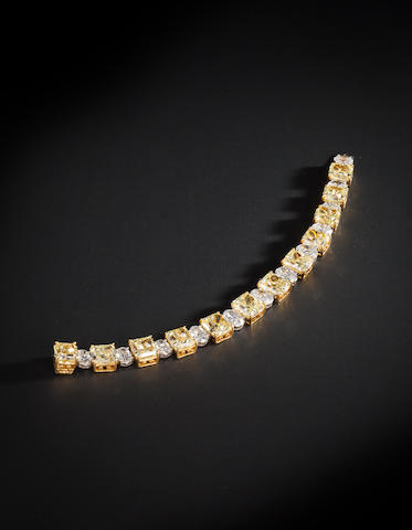 A fancy colored diamond and colorless diamond bracelet