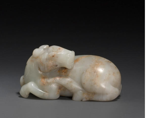 A white jade carving of a horse