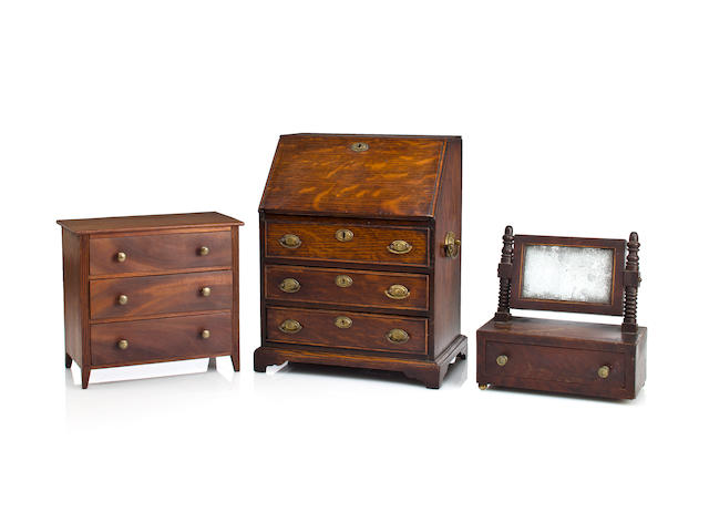 Three miniature furniture articles, including a desk, chest of drawers and dressing mirror