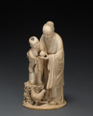 A tinted and carved ivory figural group 19th century