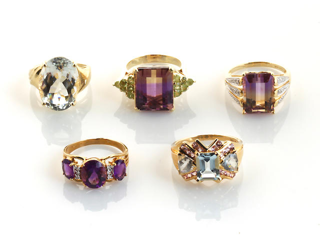 A collection of five gem-set, diamond, 14k and 10k gold rings