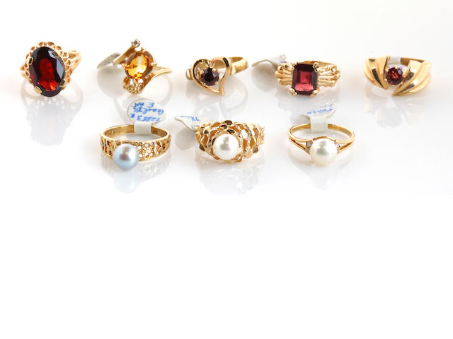 A collection of eight garnet, citrine, cultured pearl, and 14k gold rings