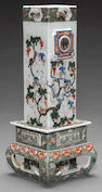 A molded famille verte porcelain rectangular vase within a shaped stand 19th century