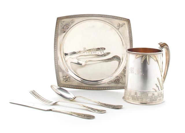 An American parcel gilt sterling silver five piece youth's place setting manufactured and retailed by Tiffany & Co., New York, late 19th century