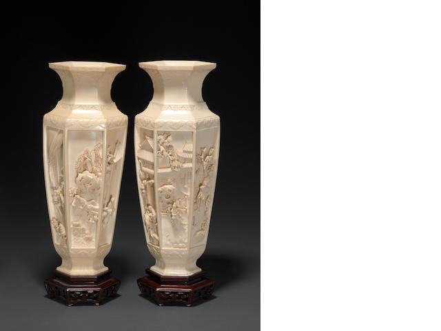 A pair of Chinese carved ivory vases
